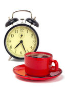 Coffee cup and alarm clock on a white background — Stock Photo