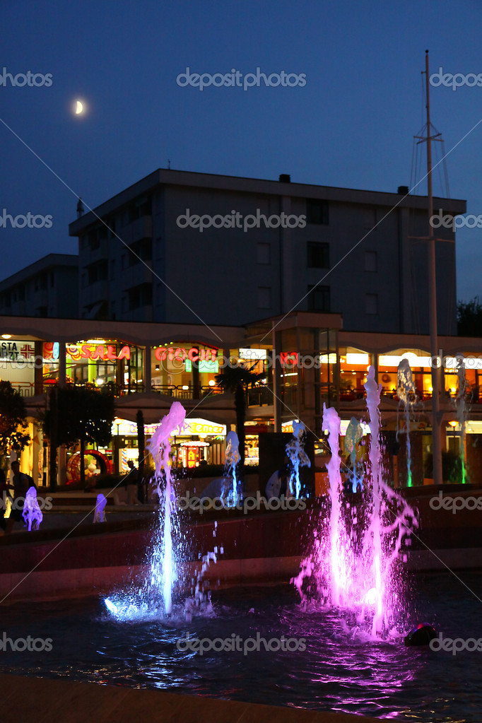 Italy by night on a piazza with a colored fountain — Stock Photo #4688522