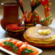 Stock Photo: Salmon fish and caviar with pancakes.