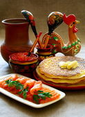 Salmon fish and caviar with pancakes. — Stock Photo