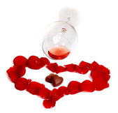 Valentine's Day - chocolate hearts, rose petals and glass. — Stockfoto
