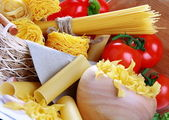 Italian pasta, red tomatoes and peppers. — Stock Photo