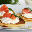 Pancakes with sour cream sauce with salmon and dill. — Stock Photo