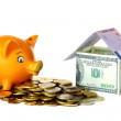 Piggy bank, gold coins and a house made ??of banknotes. — Stock Photo #5201382