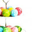 Colorful Easter eggs in a vase on a white background. — Stock Photo