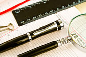 Pen on Agenda with a tools of punctuality — Stock Photo