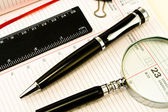 Pen and Agenda with a tools of punctuality — Stock Photo