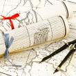 Old Maps in rolls with ribbons and compass — Stok fotoğraf