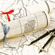 Old Maps in rolls with ribbons and compass — Stockfoto