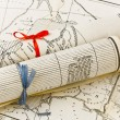 Stock Photo: Old Maps in rolls with colorful ribbons