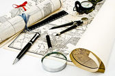 Old Maps with compass and magnifier — Stock Photo
