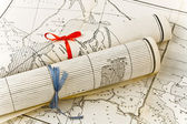 Old Maps in rolls with colorful ribbons — Stock Photo