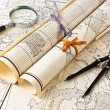 Stock Photo: Old Maps with magnifier and compass