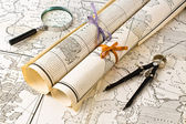 Old Maps with magnifier and compass — Stock Photo