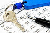 Pen, House key and Interest rates on bank loans — Stock Photo