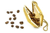 Golden metallic purse with coffee beans — Stock Photo