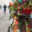 Stock Photo: Bike and flowers