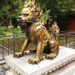 Bronze lion in Forbidden City - Stock Photo