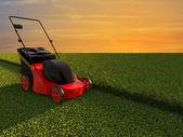 Lawn mower on green field — Stock Photo