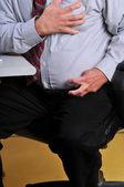 Man having heart attack at his desk — Stock Photo