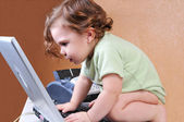 Baby riveted to the laptop screen — Stock Photo