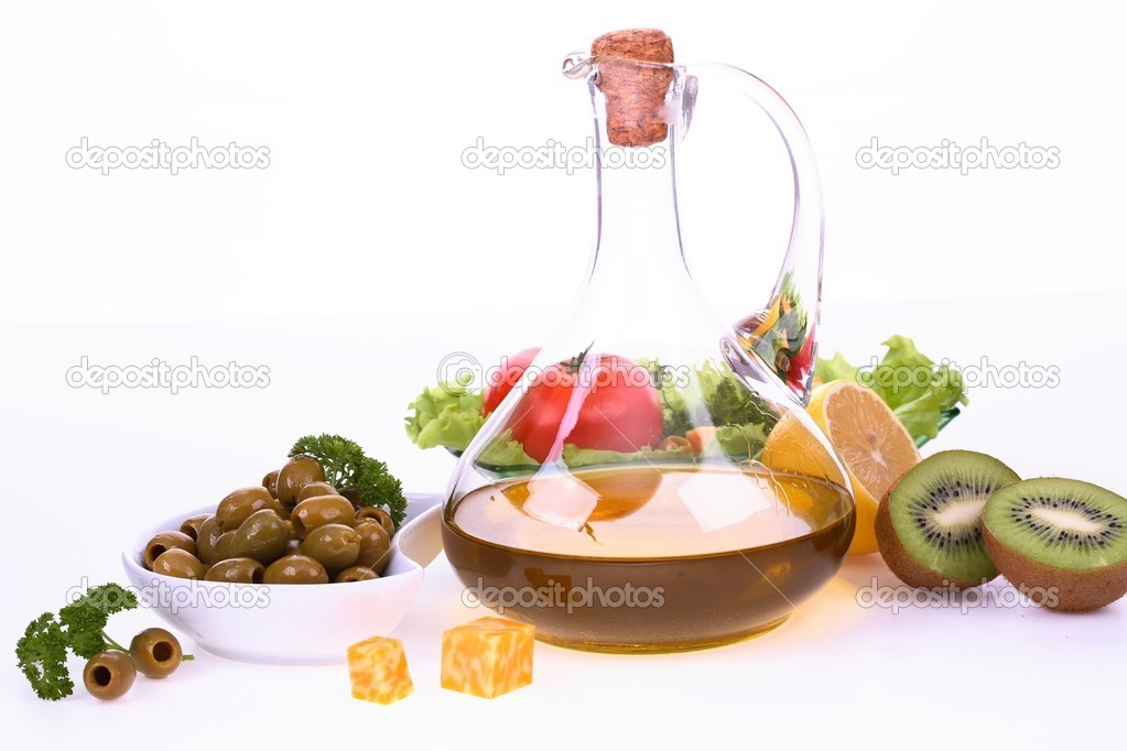 Fresh fruit, vegetables and olive oil bottle on a white background  Stock Photo #5316020