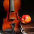 Royalty-Free Stock Photo: Violin and apple on a pile of books