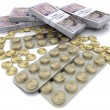 Stock Photo: Pack of tablets with coins