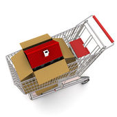 House in an open cardboard box, standing on trolley — Stock Photo