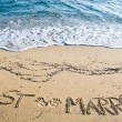 图库照片: Just Married written in Sand