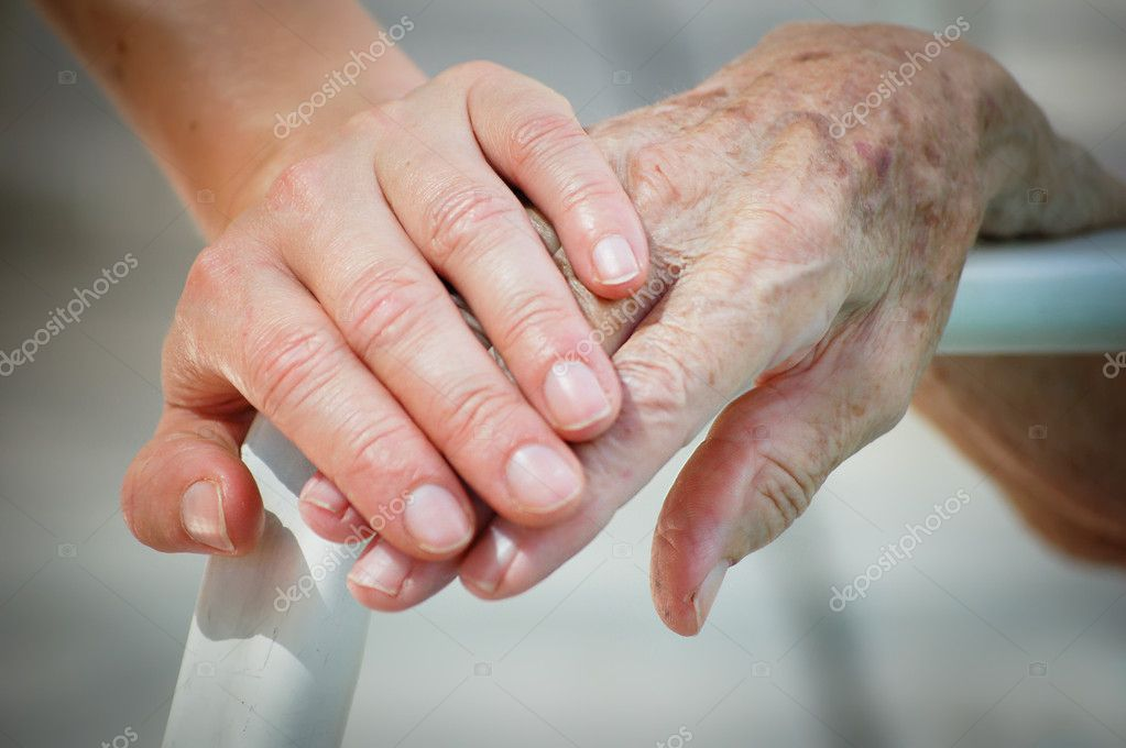 Young and old hand on a backrest — Stock Photo #4548496