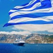 Foto Stock: Greek Flag in front of Santorini
