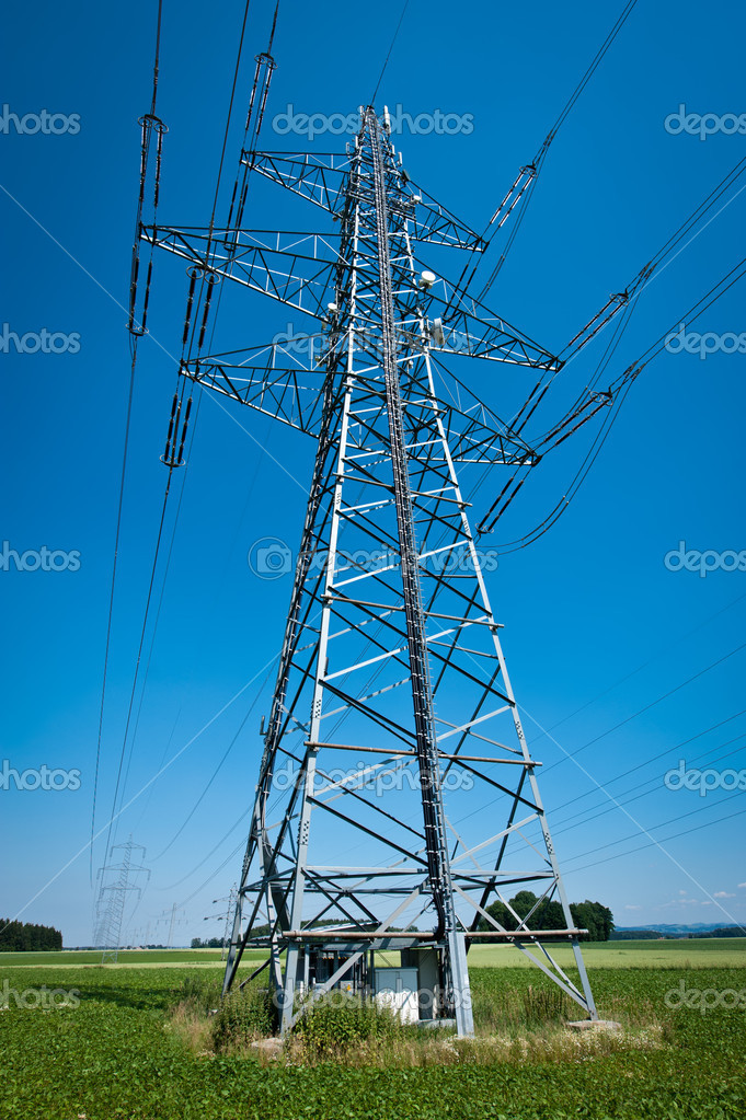 Power Line in a Summer Landscape with Blue Sky  Stock Photo #4675508
