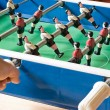 Playing Tabletop Soccer - Stock Photo