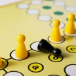 Intolerance in a Board Game - Stock Photo