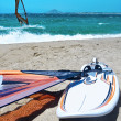 Wind Surf Board Lying On The Beach - Stock Photo