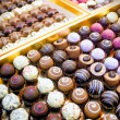 Pralines in a row — Stock Photo