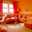 图库照片: Orange Living Room