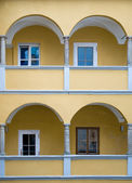 Arcade of a yellow baroque House — Stock Photo