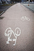 Painted cycle lane warning sign — Stock Photo