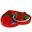 Strawberries in chocolate on red heart shaped tray with rose isolated — Stock Photo