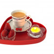 Romantic breakfast with strawberries on red heart shaped tray — Stock Photo