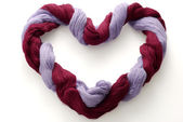 Bicolored skein of wool in shape of heart — Stock Photo
