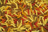 Multicolored dry pasta background — Stock Photo