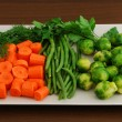 Royalty-Free Stock Photo: Colorful mix of vegetables on rectangular grey ceramic dish