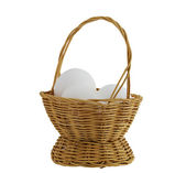Three white eggs in straw interwoven basket isolated on white — Stock Photo