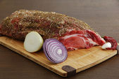 Whole piece of raw meat with spices ready for cooking — Stock Photo