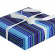 Royalty-Free Stock Photo: Present wrapped in striped blue paper with white ribbon