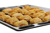 Black baking pan with fresh baked bourekas — Stock Photo