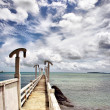Royalty-Free Stock Photo: Bridge clouds blue sea